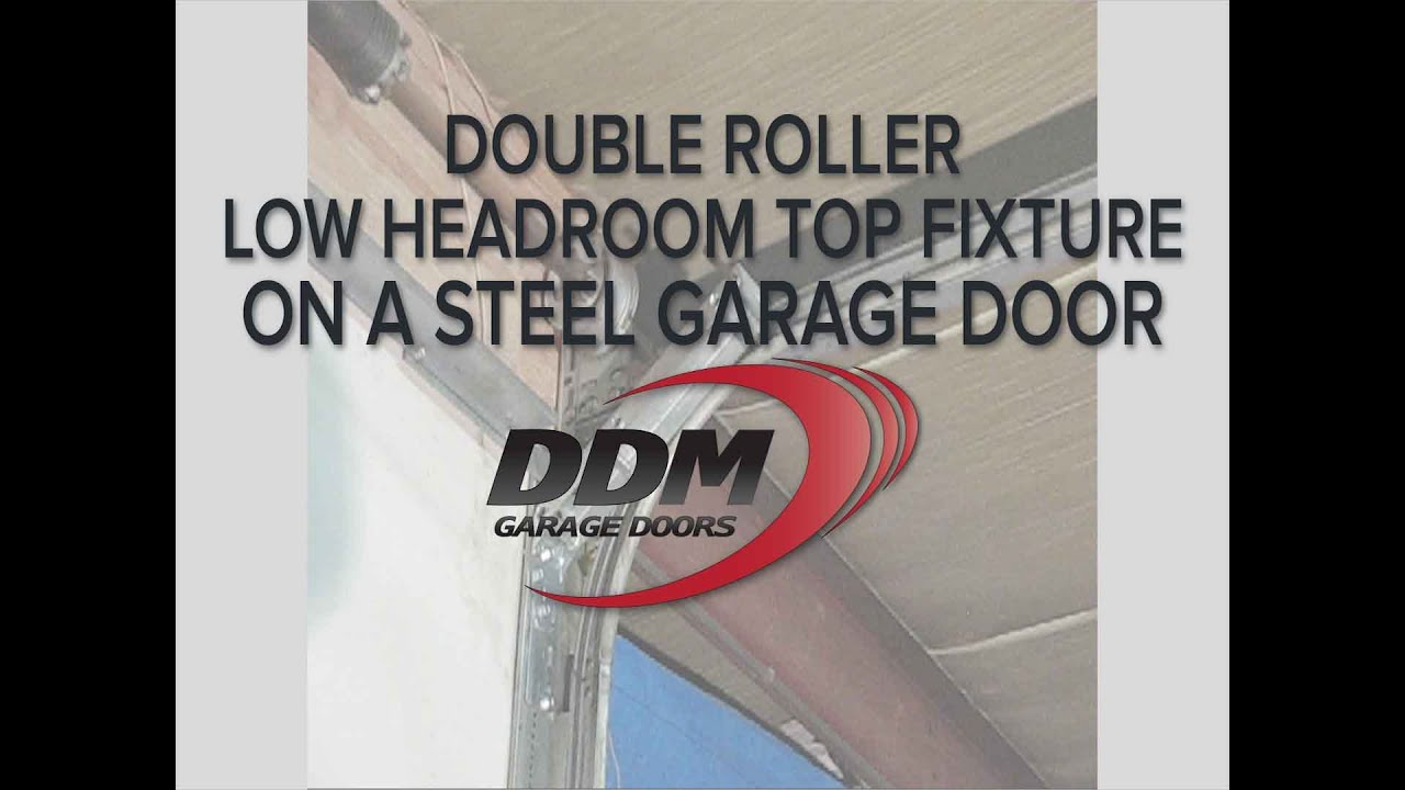 High Quality Double Roller Low Headroom Top Fixture On A Steel Garage Door