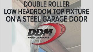 Double Roller Low Headroom Top Fixture on a Steel Garage Door