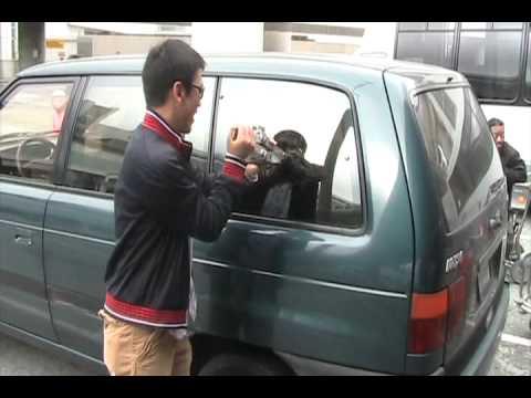 Super Guy Breaking Car Window