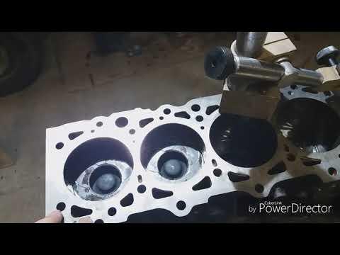 Торцовка поршней, проточка циковок под клапана.ДВС 602980.