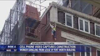 Man hangs off side of a building after scaffolding elevator collapses, 3 injured