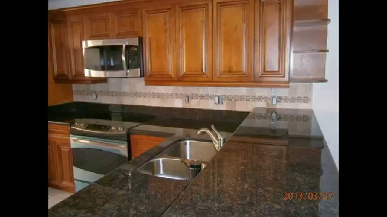 Caramel glazed kitchen cabinets with black granite west - Kitchen cabinets west palm beach ...