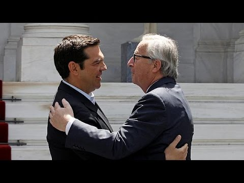 EU releases Greek bailout funds as Juncker praises Athens' reforms