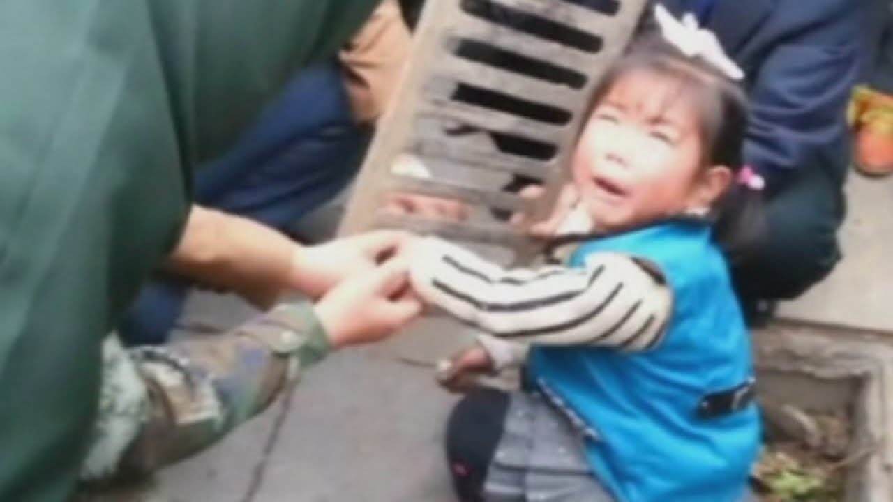 Child in China gets stuck: Girl gets hand stuck in a drain