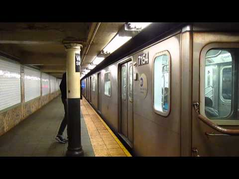 IRT Lexington Ave Line: 125 Street bound R142 (4) Train at the Wall Street Station
