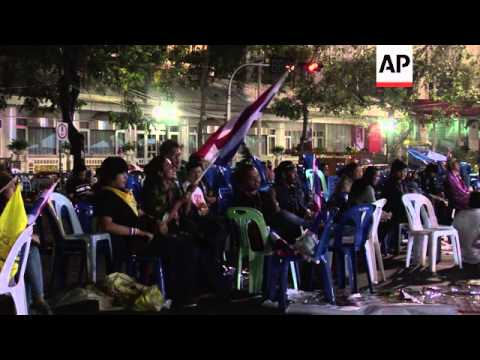 Anti government protesters camp out overnight as unrest continues; monks marching