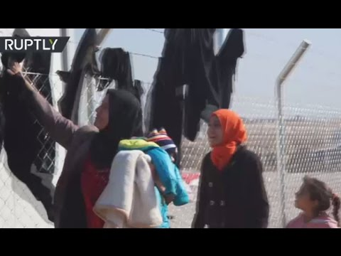 Iraqi women ditch burqas as they arrive at IDP camp after fleeing Mosul