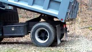 dump truck at Cabin dumping load.MOV