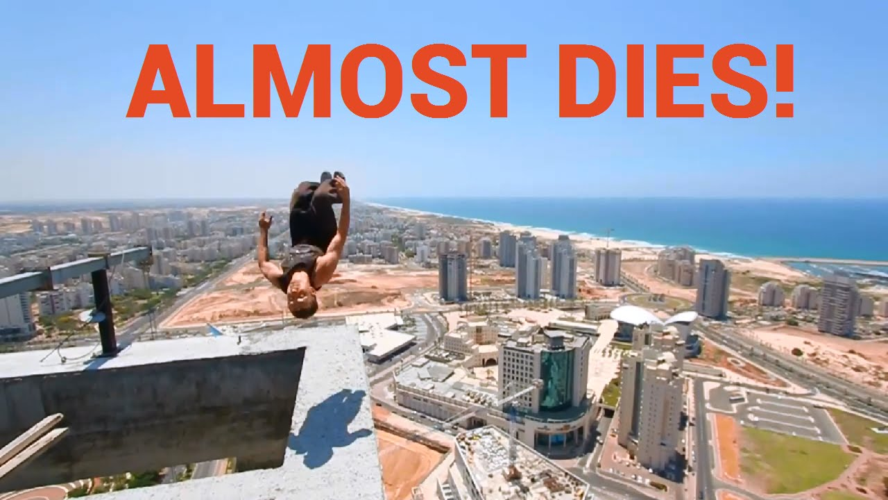 Guy Backflips On The Top Of A Skyscraper Platform Almost