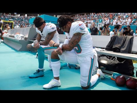 Two NFL players kneel during U.S. anthem