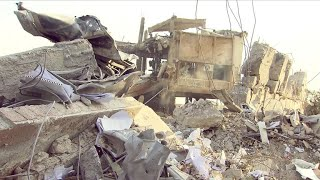 Assessing the damage of the airstrikes in Syria