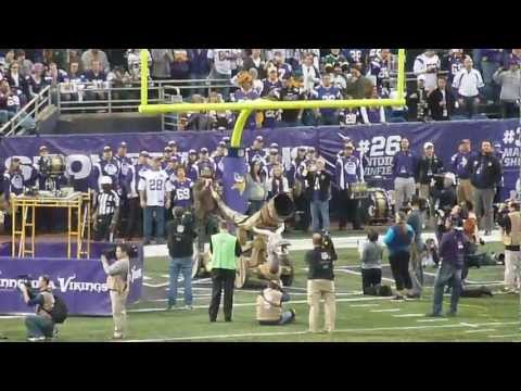 Nicholas David blows the Gjallarhorn at Metrodome before Packers vs VIkings The Voice