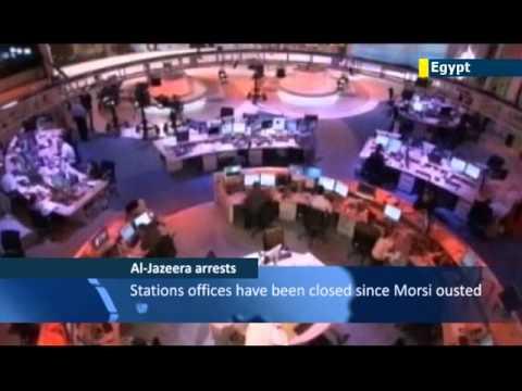 Egypt TV screens Al Jazeera arrest footage: Cairo accuses Qatari channel of Muslim Brotherhood bias