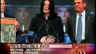 Michael Jackson rings NASDAQ bell and eats birthday cake