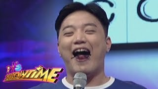 It's Showtime Copy-Cut: Ryan Bang is forced to stick his tongue out while singing a Christmas song