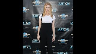 Heather Graham shows off her curves while promoting Half Magic