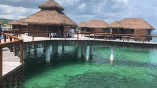 Outside view of the over the water bungalows and villas at Sandals Royal Caribbean Resort