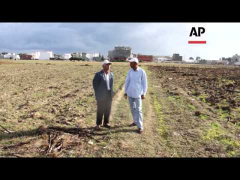 Tunisian farmer hopes elections will bring change amid continuing instability