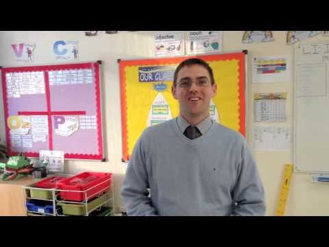 Andrew talks with a teacher about working in the International School of Moscow