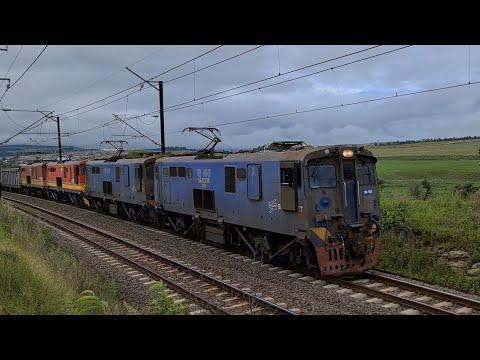 Spoornet/Transnet class 18E locomotives heading towards Durban just outside Mooiriver station.