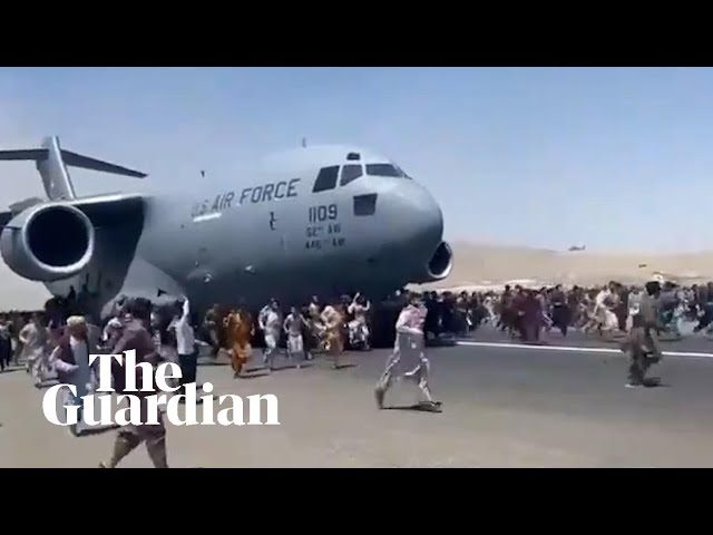 Afghans climb on to plane during takeoff in attempt to flee Taliban