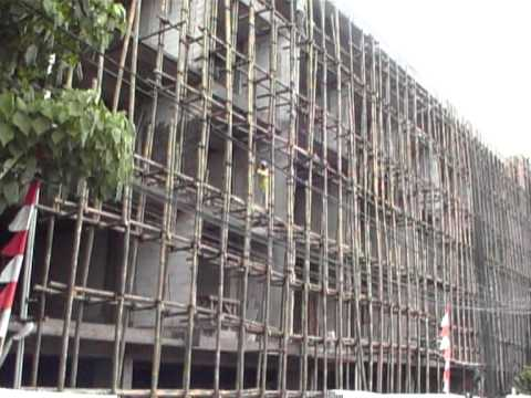Men working on new building in bali, on bamboo scaffolding.