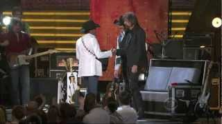George Strait singing Boot Scootin