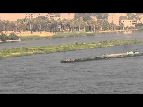 A barge on the nile riveris slowing down so rowers are not harmed 5628