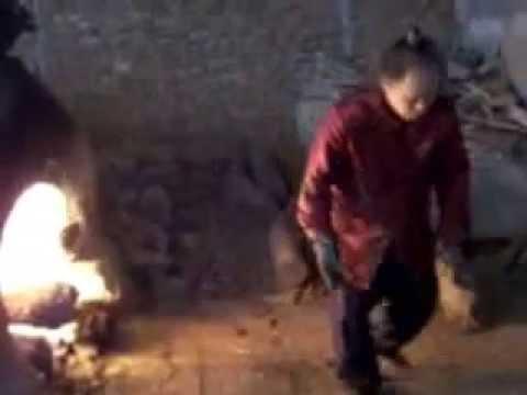 Kim, Yong Moon stokes the Dragon Kiln in Zibo