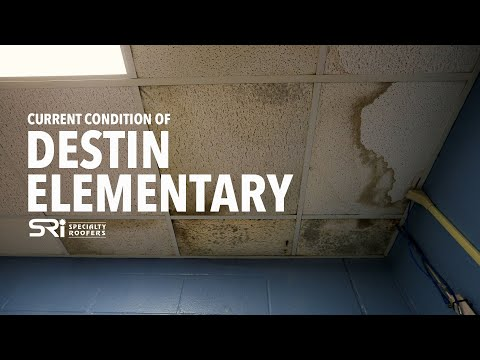 Touring Destin Elementary School to see their leaks and mold