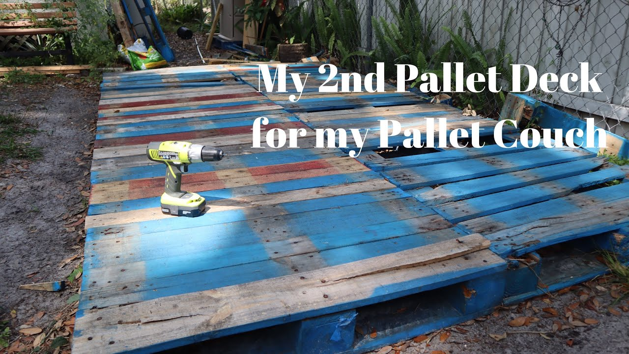 how to build a diy pallet deck in a day for beginners building my 2nd pallet deck for a pallet couch