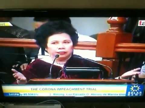 Miriam Santiago vs. Vitaliano Aguirre II blocking its ears against Miriam Santiago Feb. 29, 2012
