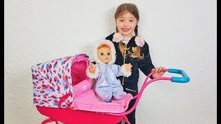 Dominika and doll doing shopping for kids