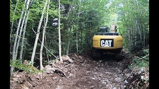 twenty trucks excavator