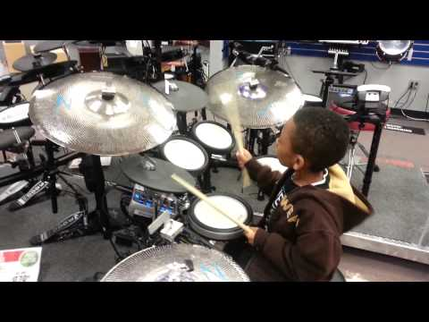 Funky drum beat by Trey (7yo) at Guitar Center