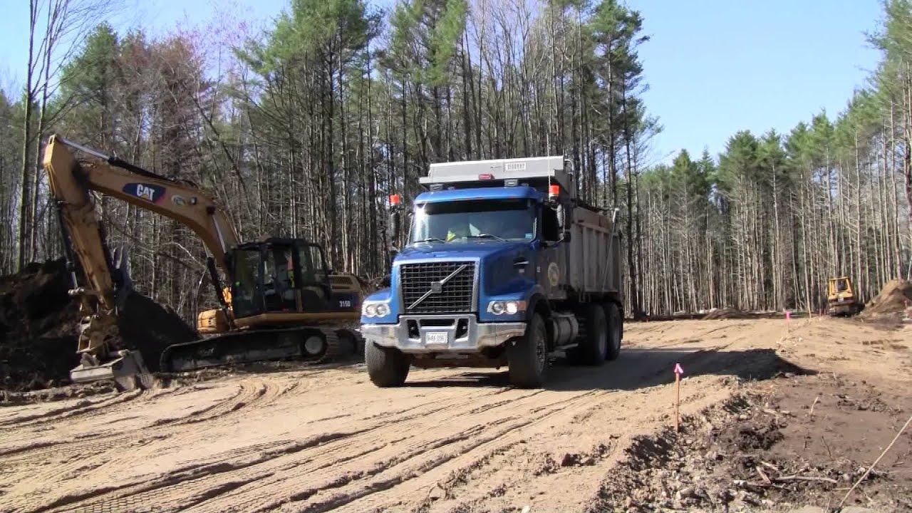 Volvo Vhd Dump Truck Dumping Its Load Youtube