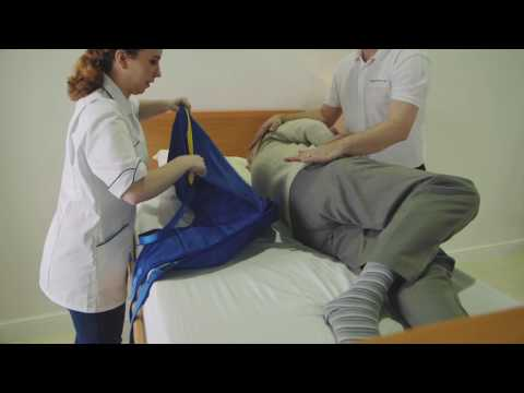 Transferring from a bed to a chair featuring the Application of a Universal Sling and A 150F Folding