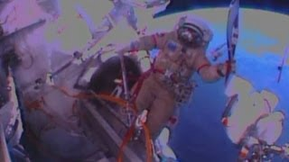 Olympic torch on spacewalk: Russian Cosmonauts pose with torch at International Space Station