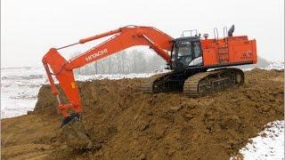 Hitachi Zaxis 670 LCH-5 im Einsatz bei Abraumarbeiten - Hitachi Excavator loading dump trucks