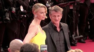 Sean Penn and Charlize Theron shows some PDA at the Mad Max Premiere in Cannes