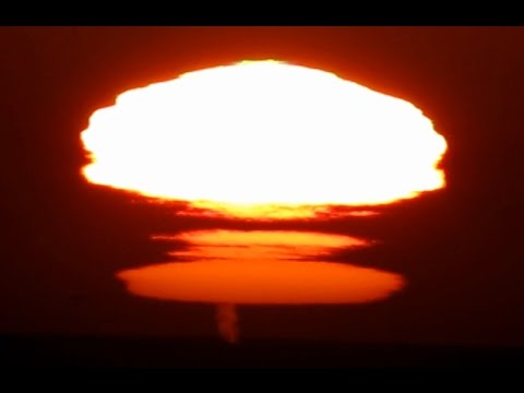 Rare and unusual The Novaya Zemlya effect sunset mirage with green flashes and whales spouts