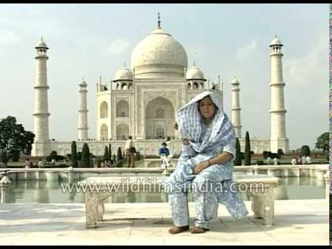 Visitors pose for traditional picture in front of Taj Mahal, with old 35 mm cameras