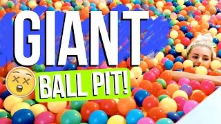 playing in a giant ball pit with vlogger friends