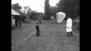 "Balloon Man with ""HEART OF THE MATTER"""