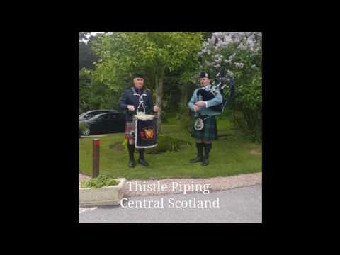Thistle Piper & Drummer