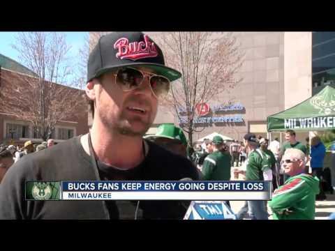 Bucks fans keep energy going despite loss.