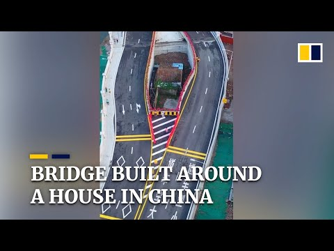 Chinese city builds bridge around house after owner refuses to move