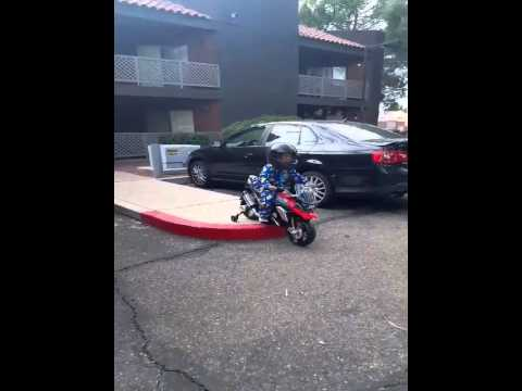 3 year old riding his power wheel bmw motorcycle - youtube