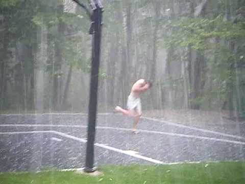 Kid Running Getting Pelted With Big Hail During A Big