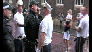 Loyalist bandsmen break determination outside St. Patricks Church